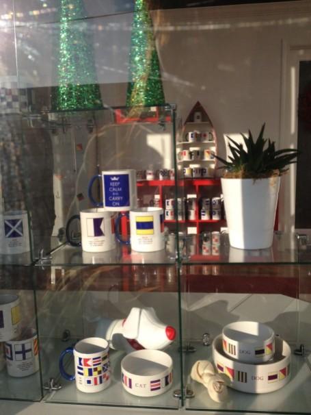 Signal flag and message mugs, $12, Style Newport (custom mugs, 4 for $55).