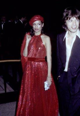 Bianca Jagger (in Halston) & Mick Jagger