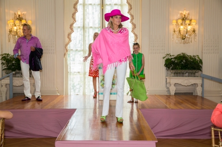 Returning model Karen Megley wearing a Claudia Nichole poncho, a Mellow World bag and Angela Moore jewelry. Karen's daughter is also in the background outfitted by the Groovy Gator.