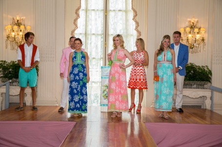 2014 Miss Rhode Island, Ivy Depew, on left, 2013 Miss Rhode Island, Jessica Marfeo, in center, Miss Rhode Island 2007, Ashley (Bickford) Karger on right, all wearing Barbara Gerwit maxi dresses.  Peter Carrellas, Justin Goff and Gavin Megley are in the background along with Angela Moore.